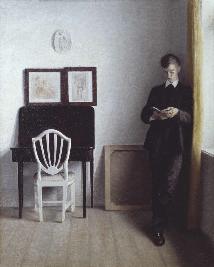 Vilhelm Hammershøi: Interior with a young man reading. 1898. The Hirschsprung Collection
