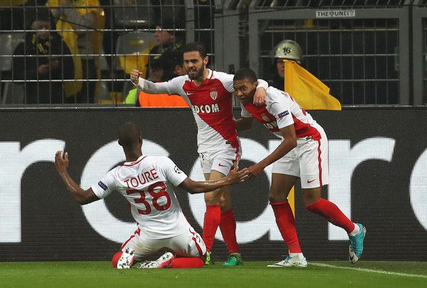 Kylian Mbappe (R) of AS Monaco celebrates scoring the opening goal with team mates during the UEFA Champions League Quarter Final first leg match between Borussia Dortmund and AS Monaco at Signal Iduna Park on April 12, 2017 in Dortmund, Germany. The match was rescheduled after an alleged terrorist attack on the Borussia Dortmund team coach as it made it's way to the stadium. - Borussia Dortmund v AS Monaco - UEFA Champions League Quarter Final: First Leg