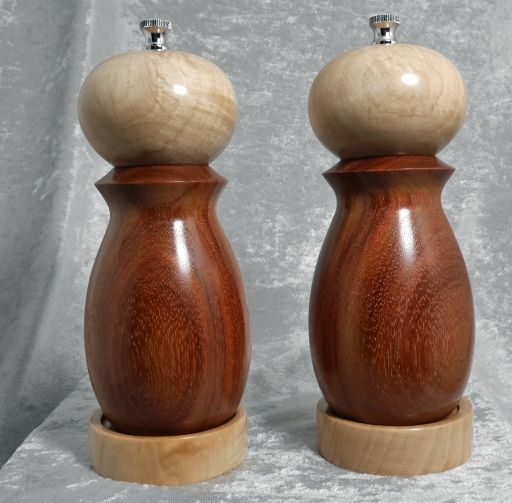 "6"" set of salt and pepper mills turned from orange agate wood and hard maple.  The salt mechanism is ceramic and will not rust.  Turned by Alaska craftsman Ted Heuer (www.tedswoodshop.com)."