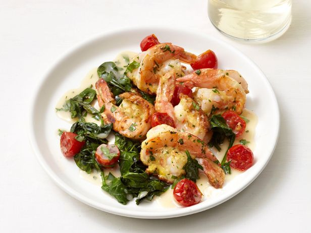 Shrimp Francese : Treat butterflied shrimp to a light breading and a quick pan-fry before combining it with spinach, burst cherry tomatoes and a lemon-and-white wine sauce.