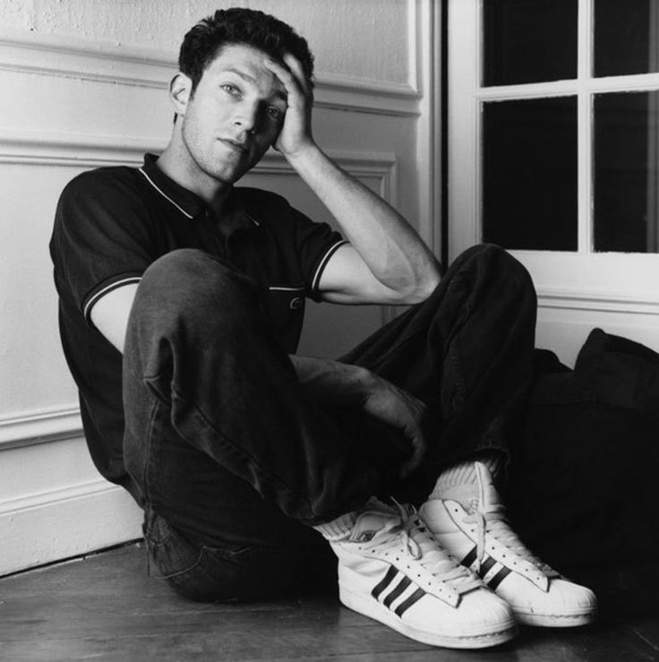 YOUNG VINCENT CASSEL WITH ADIDAS TRAINERS