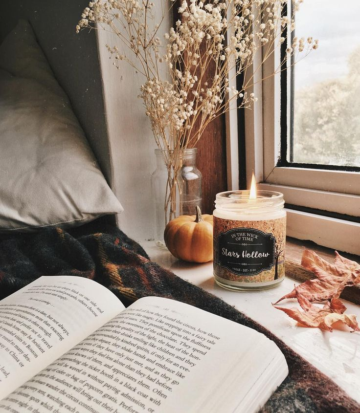 books, pumpkins, candles and leaves. autumn afternoon