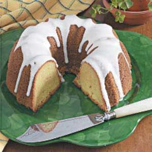 Pistachio Bundt Cake Recipe -Pistachio pudding mix gives this moist cake a pretty tint of green. As it bakes, the outside browns nicely to form a slightly crunchy crust. The cake slices beautifully and would make a fun dessert for St. Patrick's Day. -Becky Gant, South Bend, Indiana