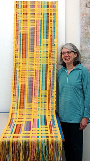 Pat Eckerdt poses with her rep weave runner.