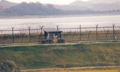 """Heavily fortified south bank of the Imjin River in South Korea.  The Imjin River comers out of North Korea where it runs much of the country, then crosses into South Korea, runs just south of the DMZ for a while then empties into the sea.  It has been called the """"River of Death"""" because of the number of North Koreans found floating in it, dead, washing down into the south.  Common during periods of famine in the North."""
