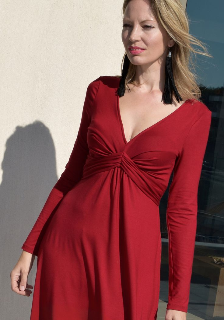 "Ruby Red Jersey Knot Draped long sleeve dress. ""Empire"" Silhouette to emphasize bust. Find all Draped Dresses in Stylati boutique."