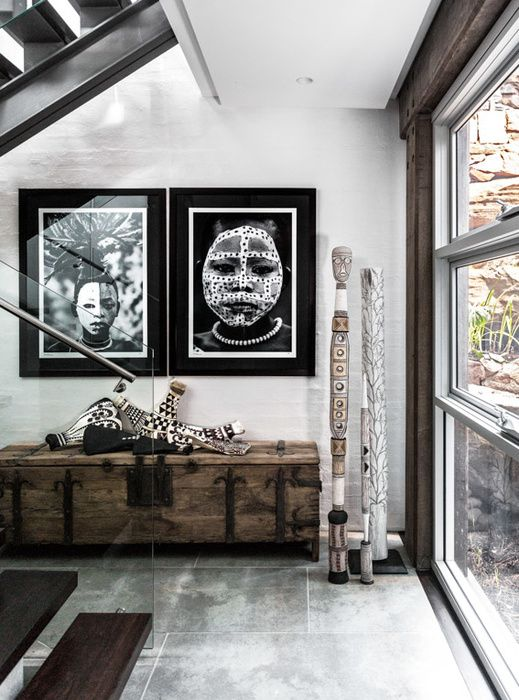 Tribal photographs and global finds in a modern interior
