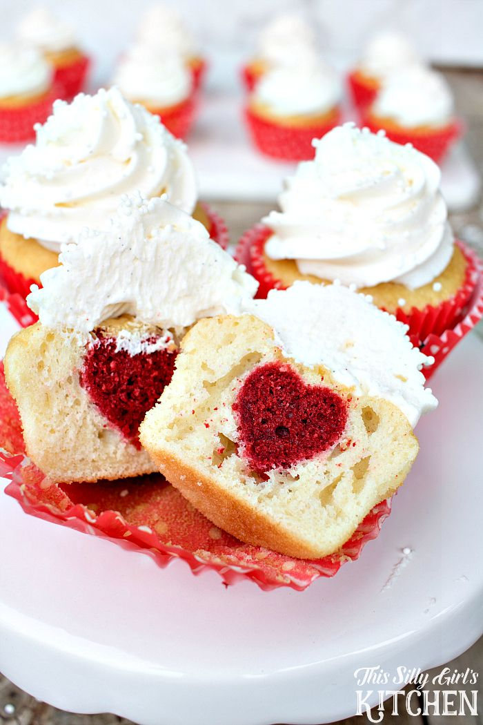 Surprise Inside Heart Cupcakes, vanilla cupcakes with vanilla buttercream frosting, with a surprise red velvet heart inside! from ThisSillyGirlsLife.com #surpriseinside #cupcakes #valentinesday