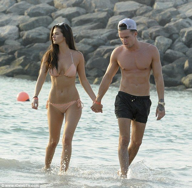 Beach babe:It was no wonder Gaz was so keen for a snuggle as Emma looked radiant in her skimpy flesh coloured bikini that showed off her toned figure