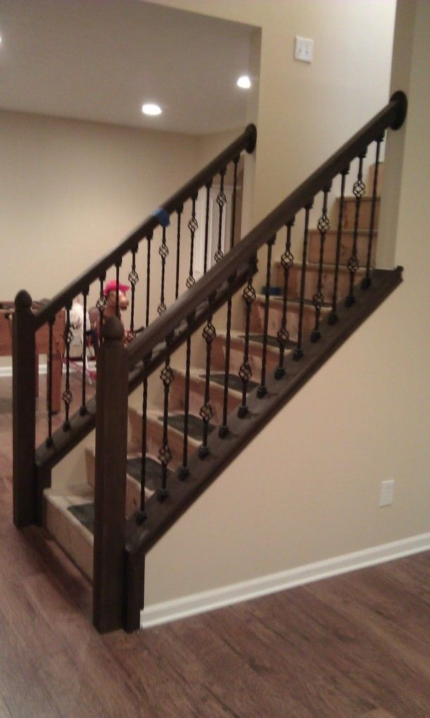 Fascinating Staircase Idea With Black Wrought Iron Baluster And Dark Brown Oak Wood Handrail - pictures, photos, images