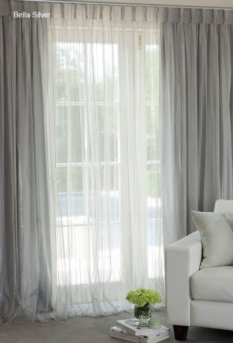 Sheer curtains over blockouts, in shimmering silver... I wouldn't do silver but sheer over blockouts is pretty
