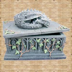 A tomb covered in ivy with a dragon protector on the lid. Inside measures 13 x 8 x 4 cms. Perfect for use as a playing card box or jewellery and trinket box. The Dragon Box brought to Skulls and Dragons by Nemesis Now.    Height : 14 cm    Width : 12 cm    Length : 17 cm    Weight : 1700.00g    Made from resin £22.99