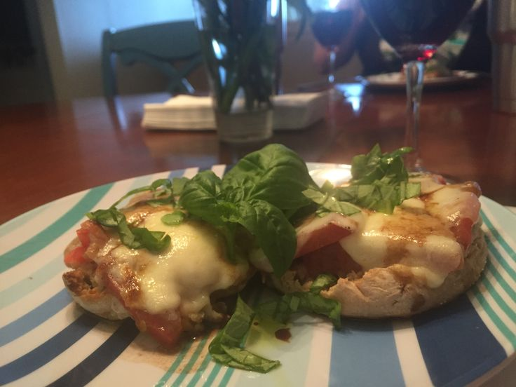 English muffin Caprese Pizza ~ Whole wheat English muffins, sliced heirloom tomatoes , fresh mozzerella ball ~ broil and top with good olive oil & balsamic and chiffonade of fresh basil leaves