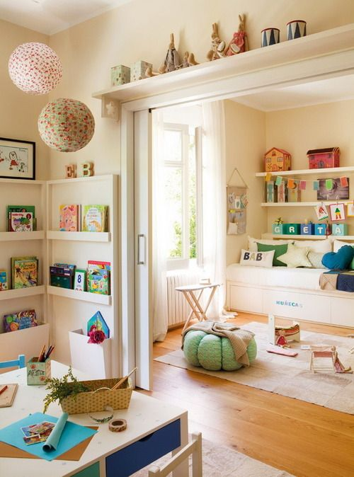 playroom + pocket doors  It would be great to have a playroom divided from a craft room in this fashion. Kids are kept out of the crafty area when you're not in there, but when you are, they can play nearby.