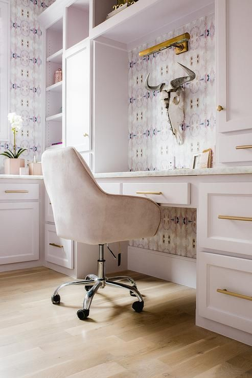 A Pink Velvet Desk Chair Is Seated In Front Of A Pale Pink Shaker Desk  Cabinets