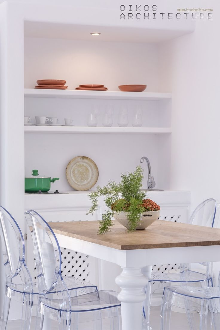 private suites, pyrgos, santorini, wooden dinning table, modern chairs, pure white, island