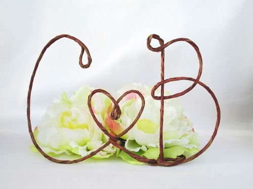 This well-hewn wire cake topper is an ideal choice for rustic celebrations. Plus, they can serve as sentimental decor after your wedding.