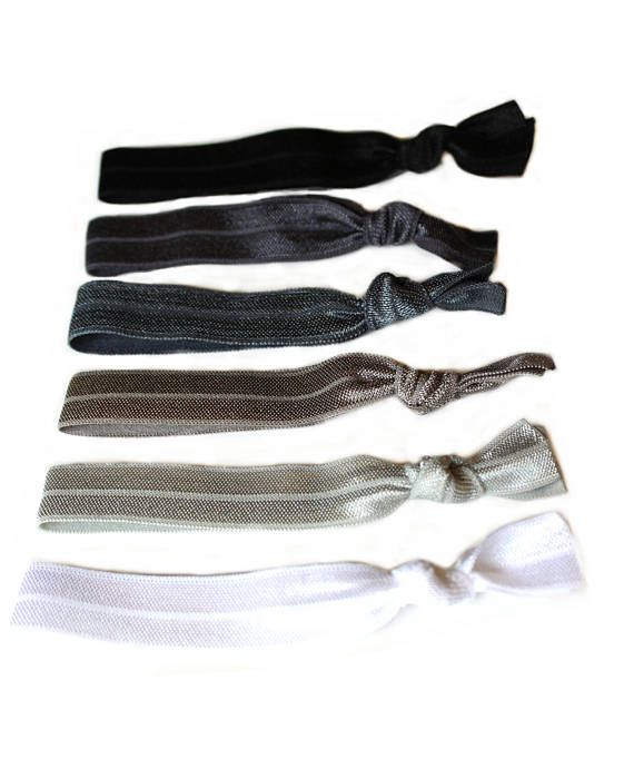 Black Ombre Elastic Hair Tie Package  This package includes: ♥ one black hair tie ♥ one charcoal hair tie ♥ one dark gray hair tie ♥ one gary hair tie ♥ one silver hair tie ♥ one white hair tie  These gentle stretchy hair ties wont crease most hair and can also be worn as stylish