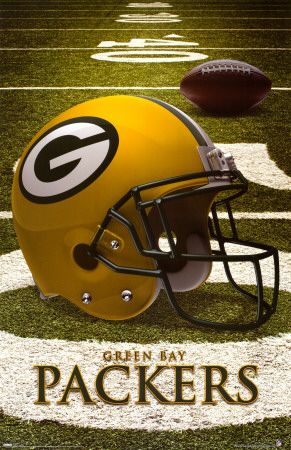 Green Bay Packers helmet on the 50 yard line with a footbal in the background.
