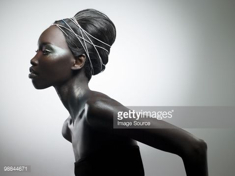 Stock Photo : Side view of woman with metallic make up