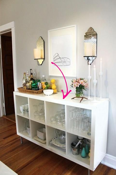 """<3 Attach legs to IKEA's white lacquer """"Expedit"""" shelving unit ($89.99) and repurpose it as a makeshift bar <3"""