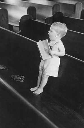 A Young Child At Church...Singing unto the Lord. Out of the mouth of babes there is perfected praise.