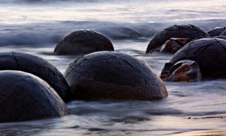 Moeraki Boulders, New Zealand  The spherical boulders that dot the beaches of New Zealand were once underwater, and, after 4-5.5 million years and as many as 165 feet of mud later, exposed to the elements. Maori legend points to the boulders as the remains of fruits and vegetables that washed ashore after a canoe wreck.