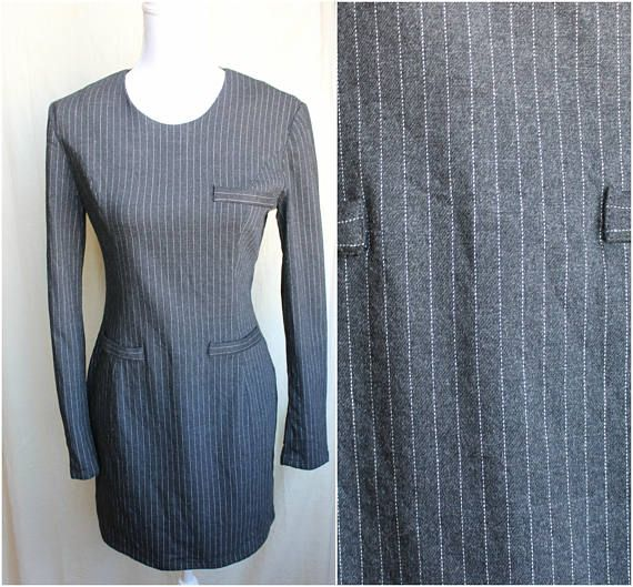 This lovely piece is a veritable Vintage Versace Jeans Couture dress. It makes an outstanding office outfit.  The dress has no signs of wear, it's in perfect condition.  Original size on label is 30/44.  Fits a size S-M.