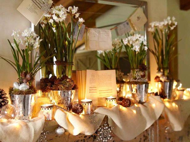 Kamin festlich dekorieren Winterpflanzen Teelichter