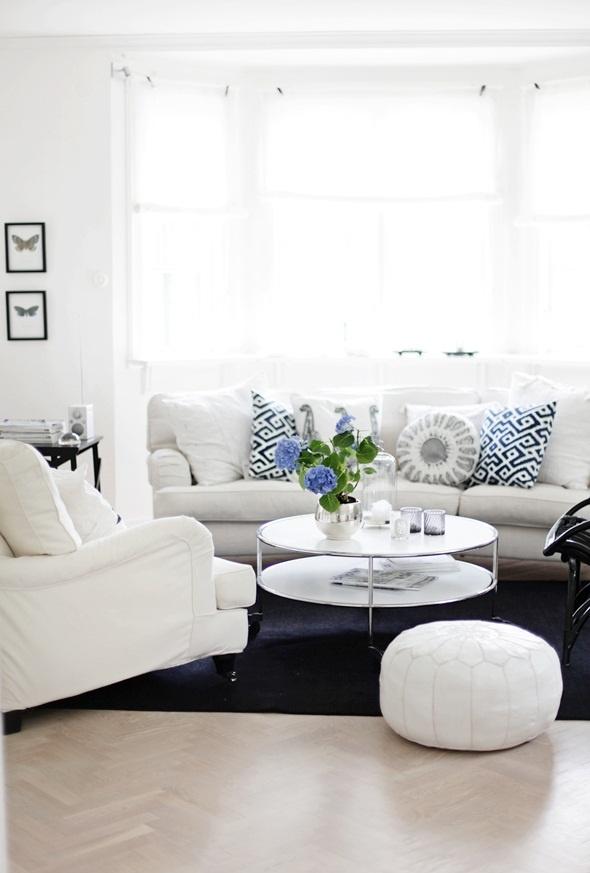 White sofa with blue pillows