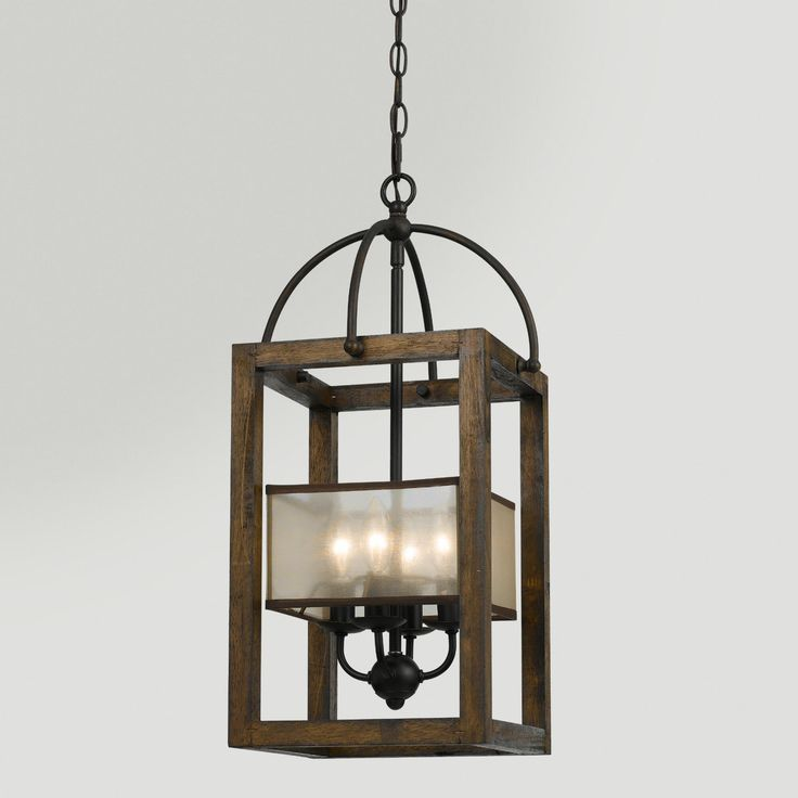 Mission Chandelier. This four-shade light fixture has a wood and metal design with a bronze and red-brown finish that's reminiscent of classic styles.