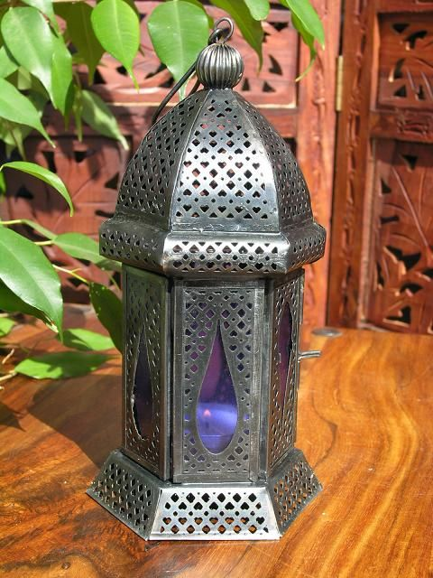 Iron lantern with blue glass. http://www.maroque.co.uk/showitem.aspx?id=ENT04843&s=21-40-117