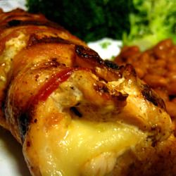 Grilled chicken stuffed with cheese and wrapped in bacon.