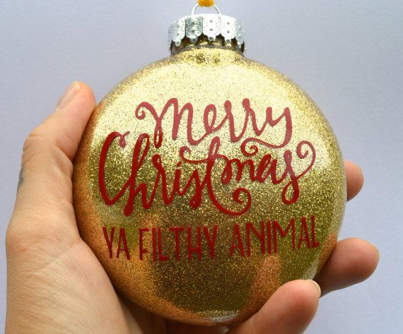 Keep the change, ya filthy animal! Keep this awesome ornament for yourself or gift it to YOUR favorite filthy animal this holiday season  This shatterproof christmas ornament is filled with bright gold glitter (keeping it on the inside keeps the mess away, no flaking!) with a deep red permanent vinyl decal applied on top. A subtle and hilarious nod to a favorite Christmas-time movie Home Alone!   Happy Holidays ya filthy animals