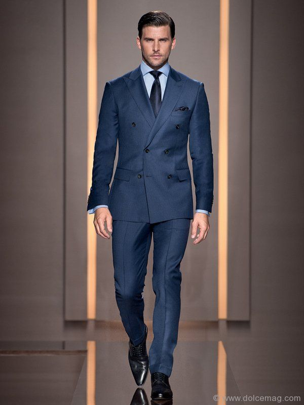 Every man needs a power suit, either black or navy. The kind of suit you can wear to the boardroom meeting, you can wear it out in the evening to a special event, it can be worn really dressed up with a white shirt or you can put it with a blue or striped shirt for less formality. It's your core power suit. 'Harwick/Corner' suit by BOSS Selection 'Casin' shoes by BOSS Selection