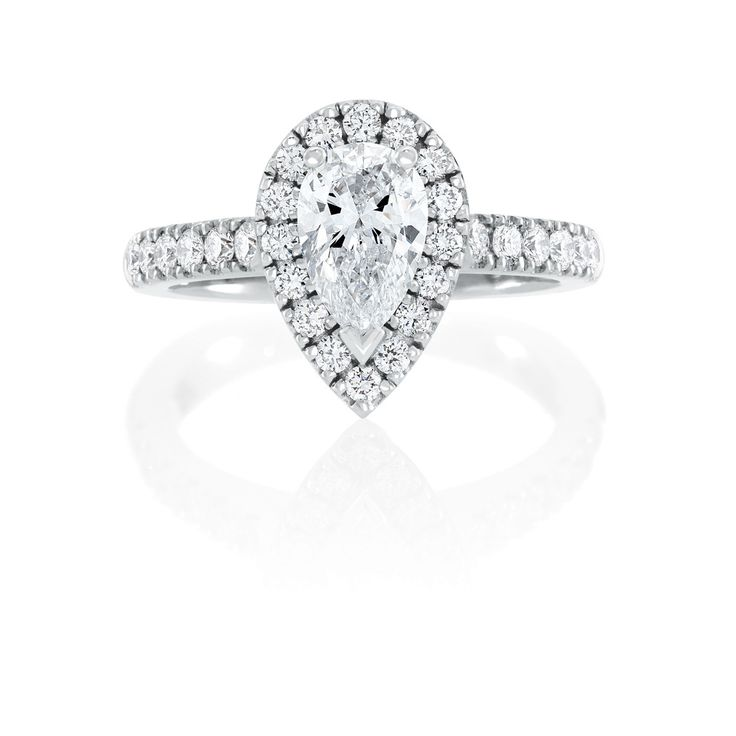 Saachi 'Pear Mahina' -This halo ring is set with the focus on the magnificent Pear Cut Diamond surrounding by smaller Round Brilliant Cut Diamonds to radiate romance and brilliance.
