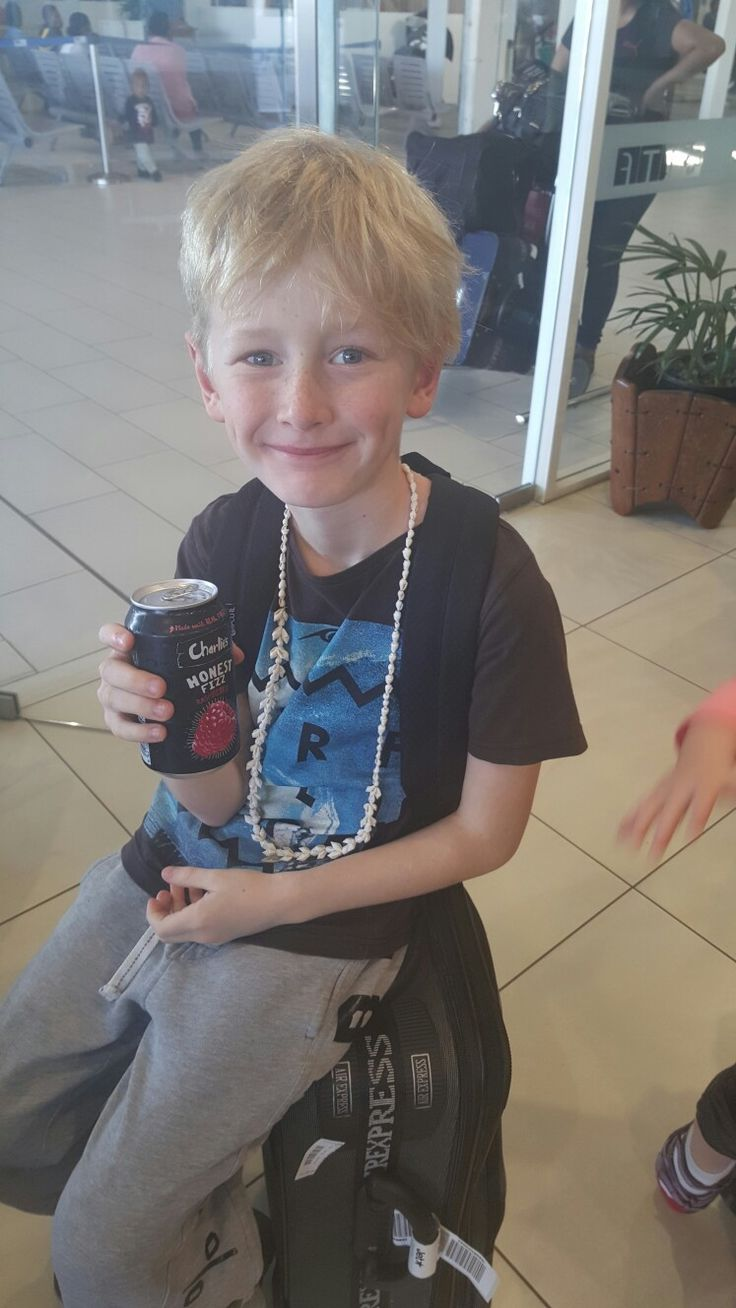 Nadi - refreshing drink and a necklace for ollie. Nadi airport.