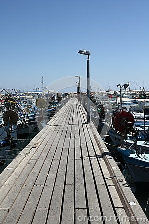 Fishing boats moored on both sides of the pier after fishing in Larnaca. Cyprus, Greece