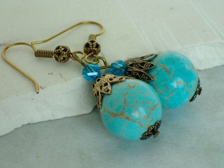 A personal favorite from my Etsy shop https://www.etsy.com/listing/454612430/turquoise-gemstone-beaded-boho-dangle