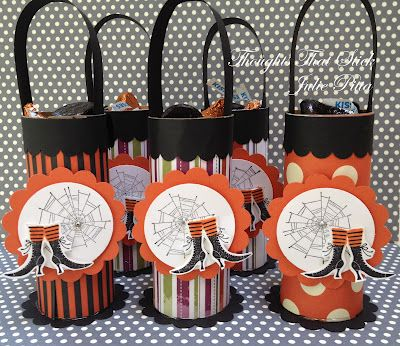 They are just toilet paper rolls that have been covered in the Howlstooth and Scaringbone DSP and some retired (gasp!) DSP, then decorated with the images from the Wicked Cool stamp set and filled with of course Hershey's Halloween kisses!  yumo!