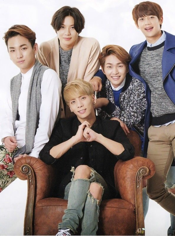 SHINee lol I looks like Minho is about to punch Jonghyun in the back of the head. Noo don't do it!