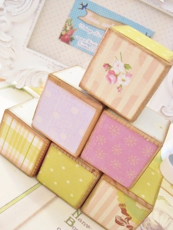 I'm thinking big foam blocks to use for deco at the shower then fun toys for the nursery :)