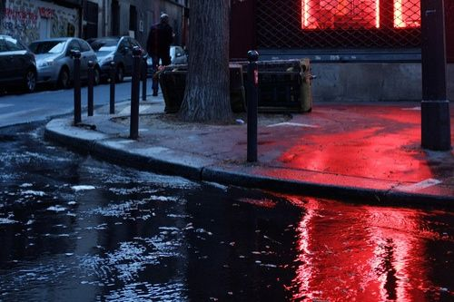 Wet streets in winter that let red light bleed everywhere