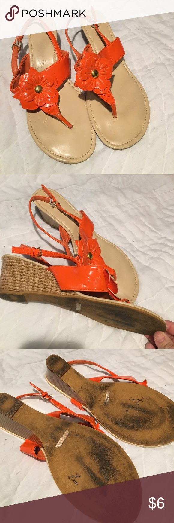 cute wedge sandals Orange and no marked brand and worn  so selling cheap or bundle and include for FREE Just let me know or make an offer minus this cost. Size 10. not marked but they are a 10 Shoes Sandals