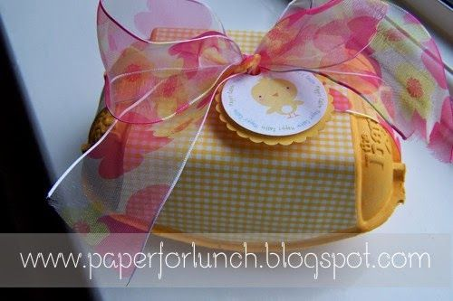 Easter Basket alternative.  Fill with wrapped chocolate Easter eggs, candy filled plastic eggs or a Kinder Surprise for an extra treat.  I got the tags at Tipjunkie. Just search for Easter Cupcake Toppers. This is a Happy Egg carton which comes yellow but I've also painted cartons to match my ribbon.