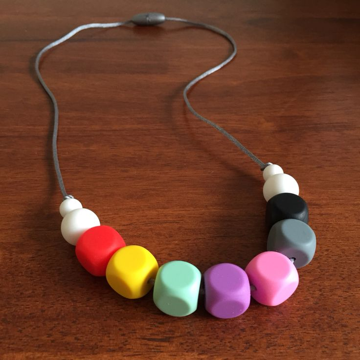 Silicone Teething Necklace - Fussy Little Fox Cubed Teething Necklace in red, yellow, mint, purple, pink, grey, black and white on silver nylon cord with silver safety catch. $20 + Free Shipping within Australia. Visit Fussy Little Fox on Facebook to see more or email fussylittlefox@gmail.com to purchase.