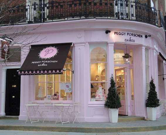 Peggys cupcake shop in London: Love the awning, topiaries, details