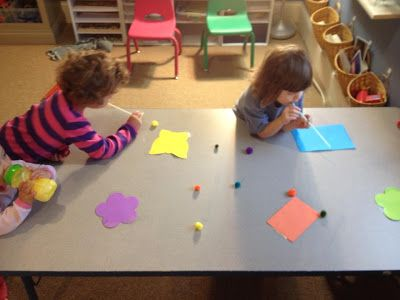 Oral Motor control.....tape colored paper to a table and have the children blow pom-poms through a straw onto its corresponding color.