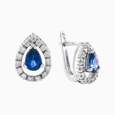 These classic gemstone and diamond earrings showcase 1.20ct of vibrant blue pear-cut sapphires framed by a dazzling halo of diamonds pavé-set, with total weight 0.42 ct in 18k white gold