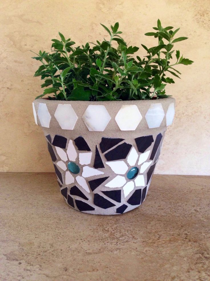 A personal favorite from my Etsy shop https://www.etsy.com/listing/464619172/mosaic-planter-rustic-flower-pot-outdoor